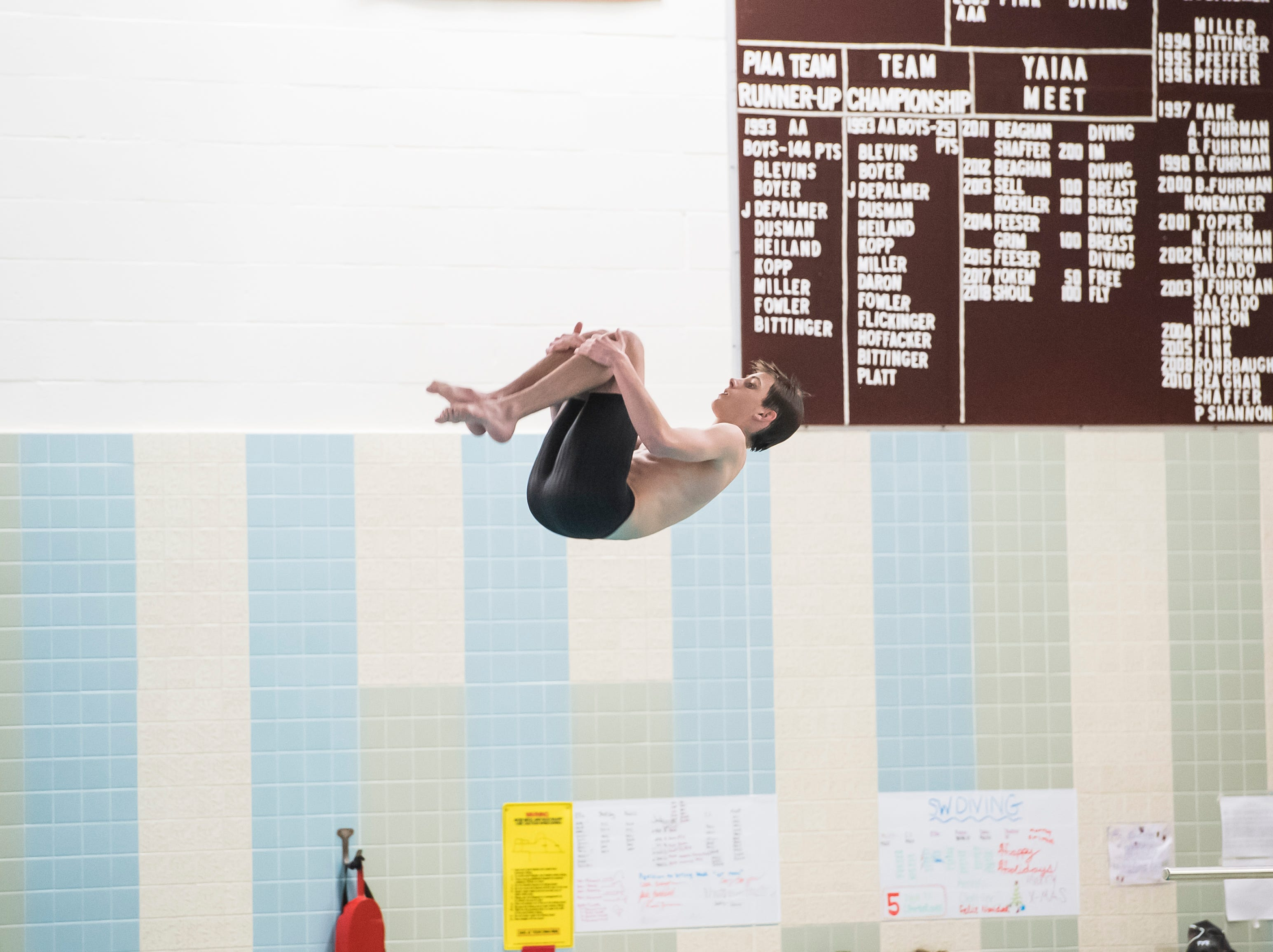 A diver competes during a meet between Gettysburg and South Western at Emory H. Markle Intermediate School on December 20, 2018.