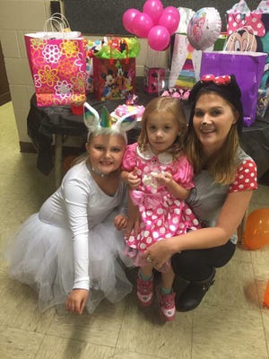 A photo of Carly, Isabella and Kayla Sheridan at their combined Halloween and birthday party in 2018.