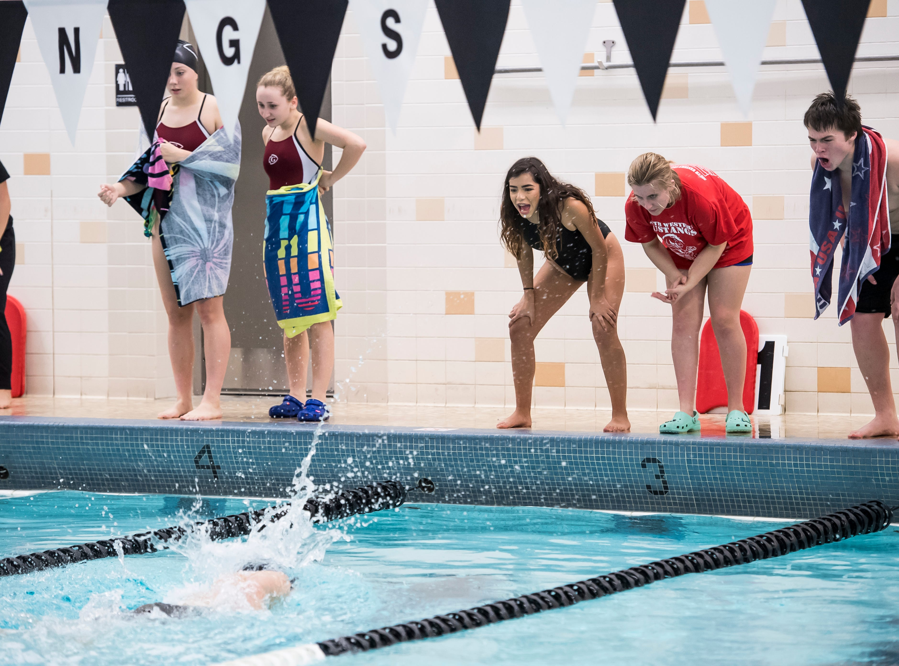 South Western swimmers cheer on one of their teammates in the boys' 200 free race during a meet between Gettysburg and South Western at Emory H. Markle Intermediate School on December 20, 2018.