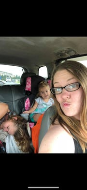 Kayla Sheridan is asleep in the back seat with her daughter Isabella, as Jen Lawson drives to Chocolate World.