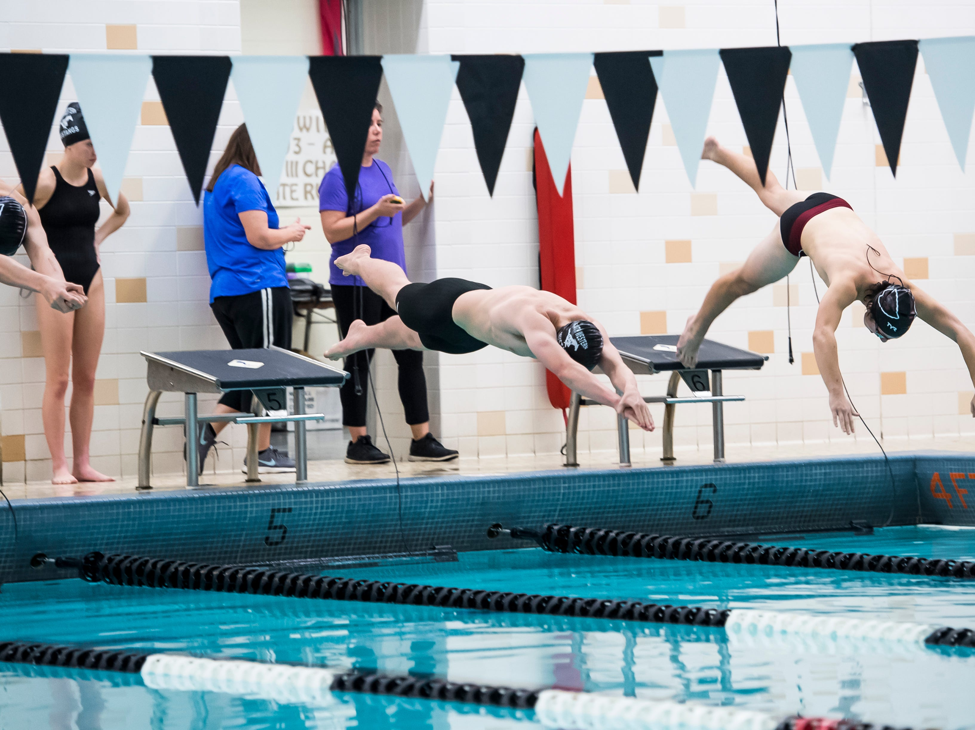 Swimmers dive off the blocks in the boys' 200 individual medley during a meet between Gettysburg and South Western at Emory H. Markle Intermediate School on December 20, 2018.