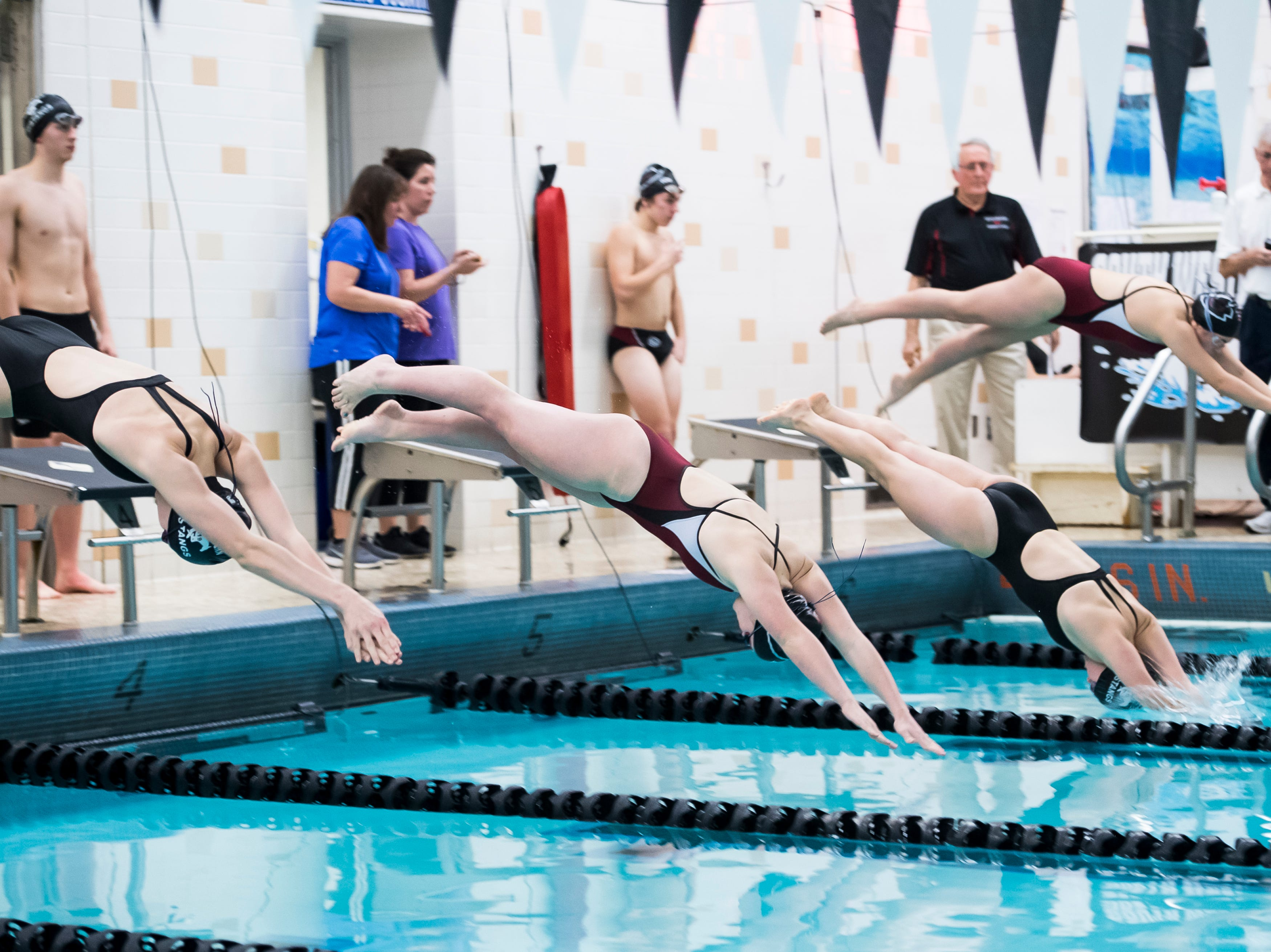 Swimmers dive off the blocks in the girls' 200 individual medley during a meet between Gettysburg and South Western at Emory H. Markle Intermediate School on December 20, 2018.