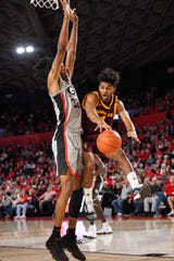 Arizona State Sun Devils guard Remy Martin (1) tries to pass around Georgia Bulldogs forward Nicolas Claxton (33) during the first half at Stegeman Coliseum Dec. 15, 2018 in Athens, GA. Dale Zanine-USA TODAY Sports