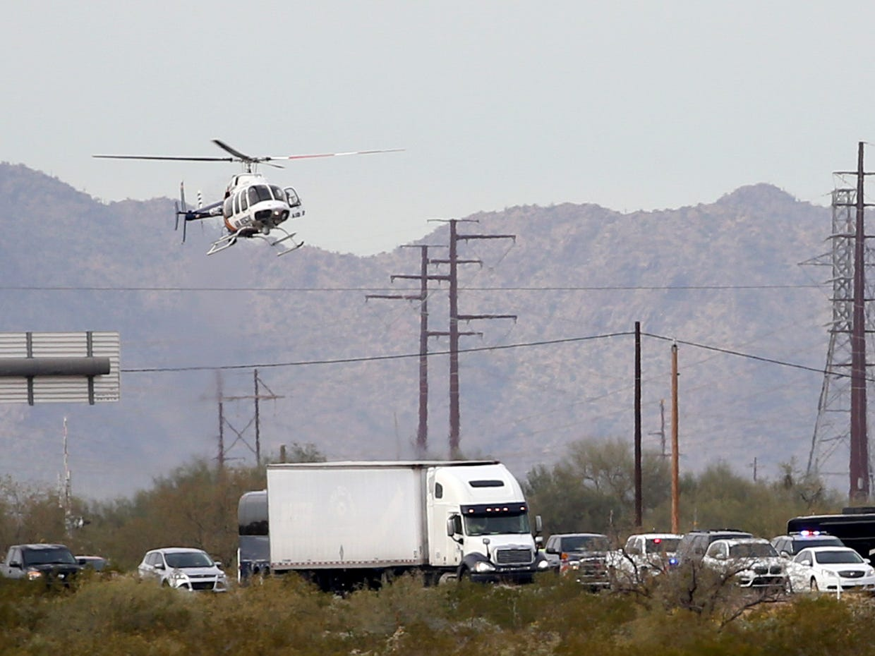 Department of Public Safety's helicopter comes in for a landing on the scene of a multiple fatality collision on I-10 west of Pinal Airpark Road on Dec. 21, 2018, near Tucson.