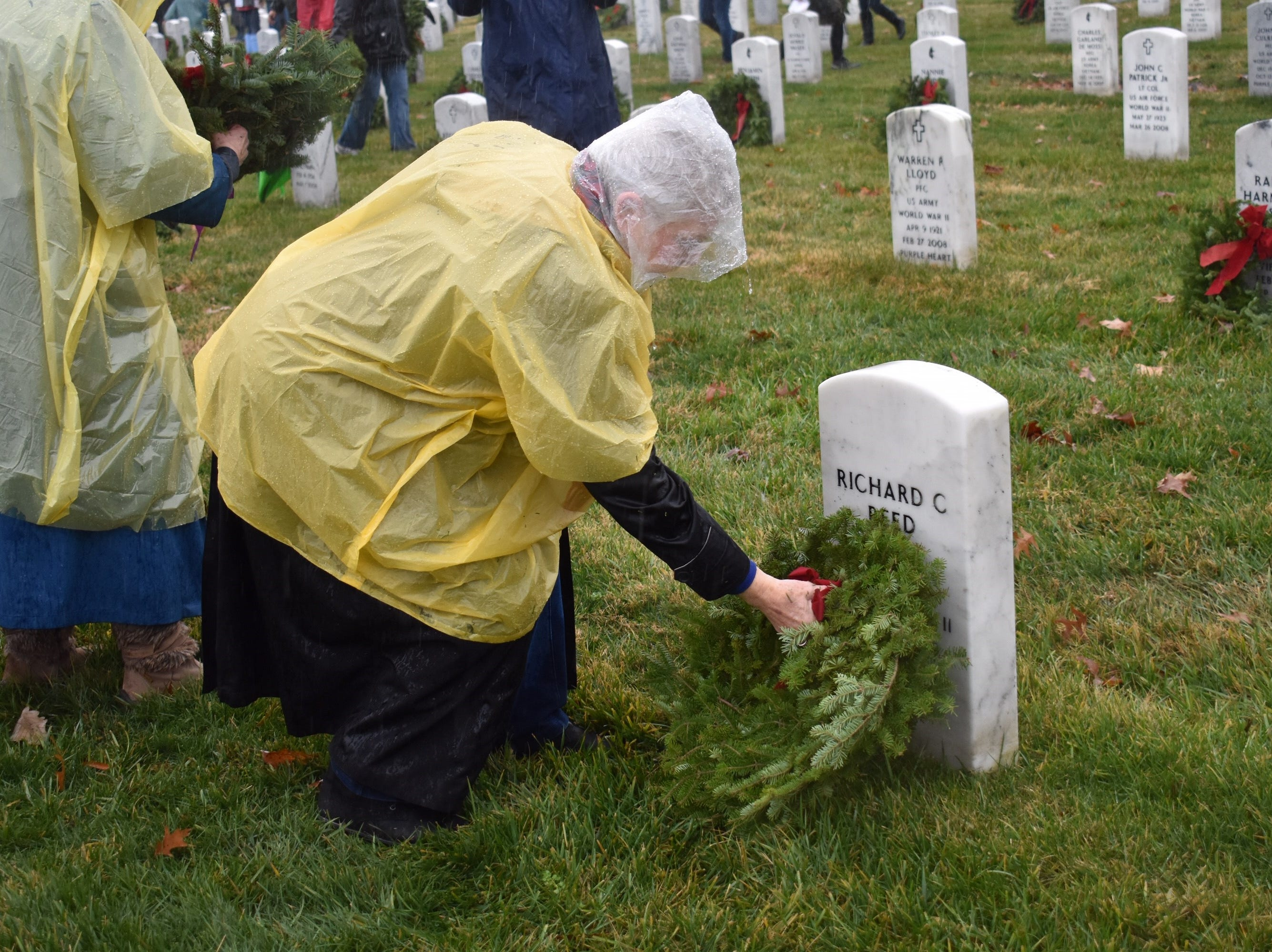 Celene Post, of Chandler, and national program chair for the General Federation of Women's Clubs, an international service organization, places a wreath on a grave at Arlington National Cemetery in Virginia on Dec. 15, 2018.