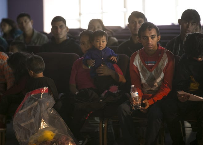 Asylum seekers and migrants from Central America wait at La Hermosa Church in Phoenix after being dropped off by U.S. Immigration Customs and Enforcement on Dec. 20, 2018.