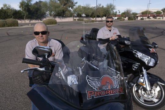 Travis Rowland, on left and Tom Lombardi owners of ProRider-Phoenix, a motorcycle training school poses for a photo at VIA Church parking lot in Mesa. Travis and Tom are police officers who used to provide advanced motorcycle training to police motorcyclists, and now they offer this training to civilians in an effort to reduce risk of crashes and fatalities.