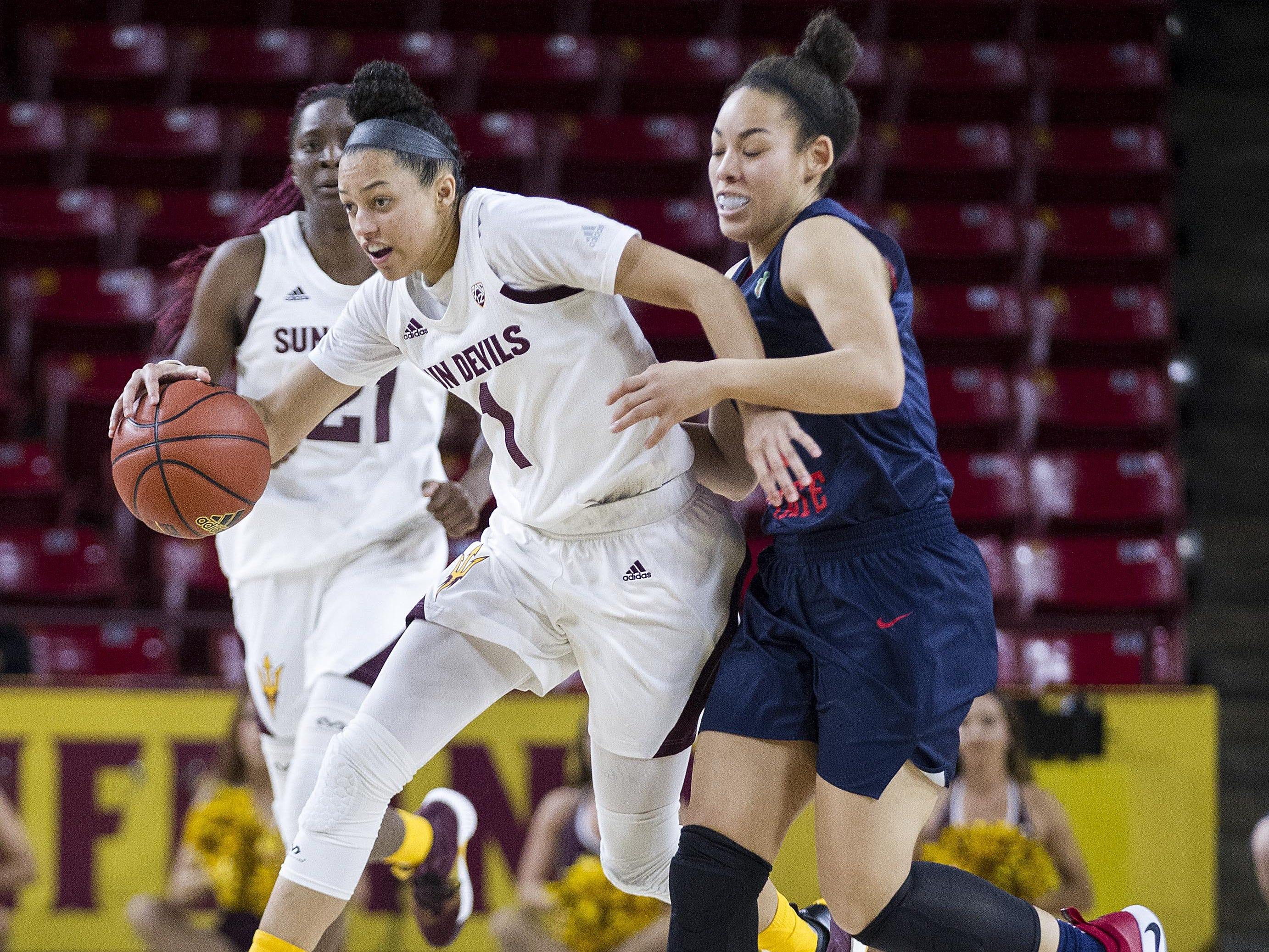 Arizona State's Reili Richardson (1) drives around Fresno State's Candice White (10) in the second half of their game in Tempe, Thursday, Dec. 20, 2018.