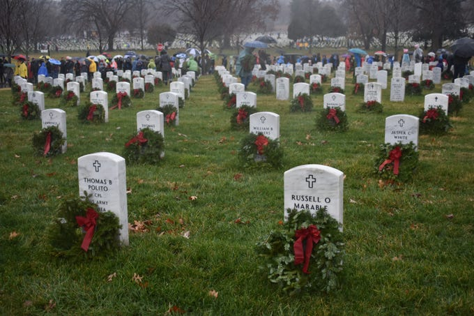 Nearly 60,000 volunteers turned up from across the country to place 253,000 wreaths against the white tombstones at Arlington National Cemetery on Dec. 15, 2018. The wreaths remain on display until Jan. 19.