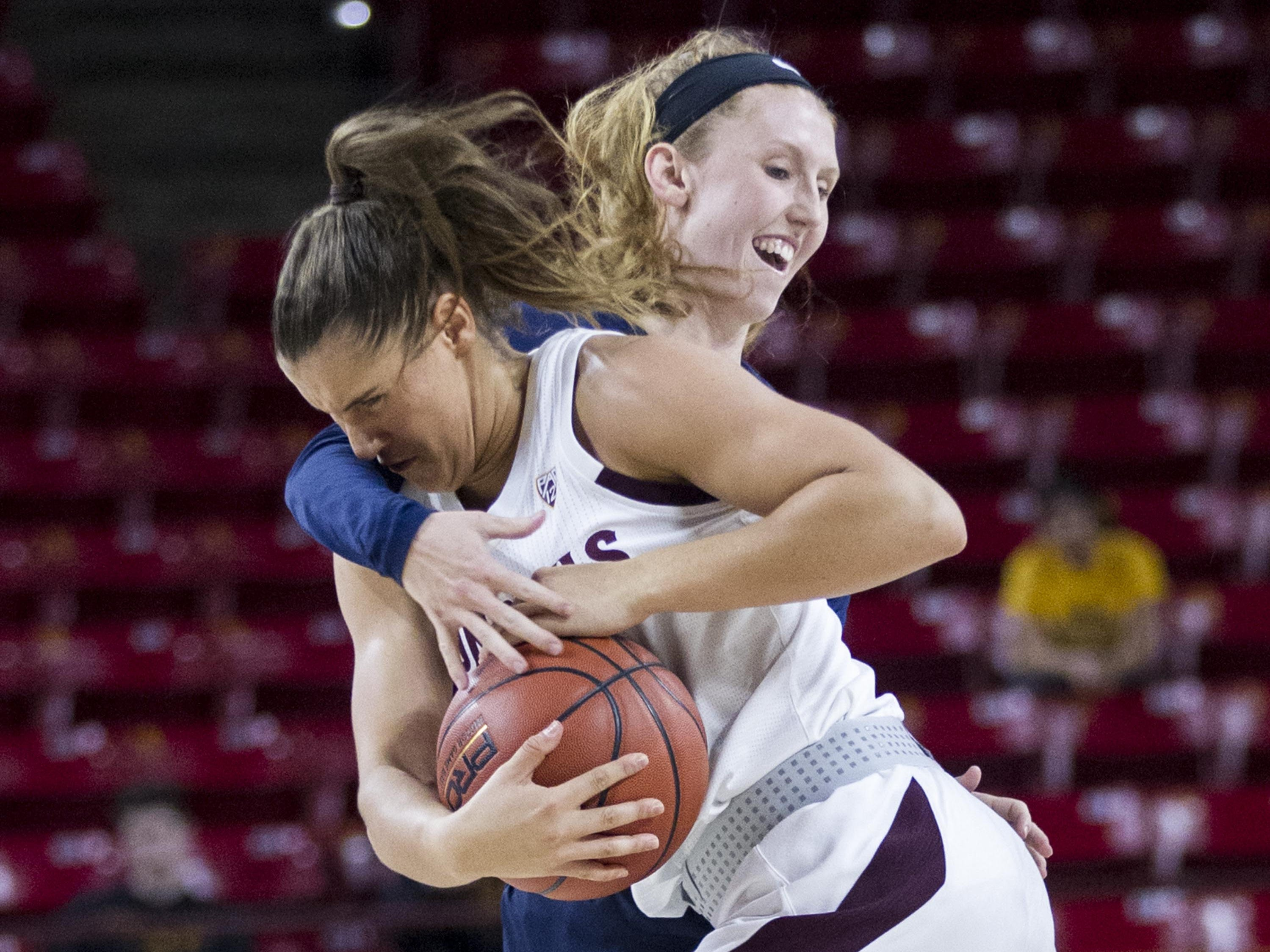 Arizona State's Taya Hanson (0)  gets fouled by Fresno State's Kristina Cavey (30)  in the second half of their game in Tempe, Thursday, Dec. 20, 2018.