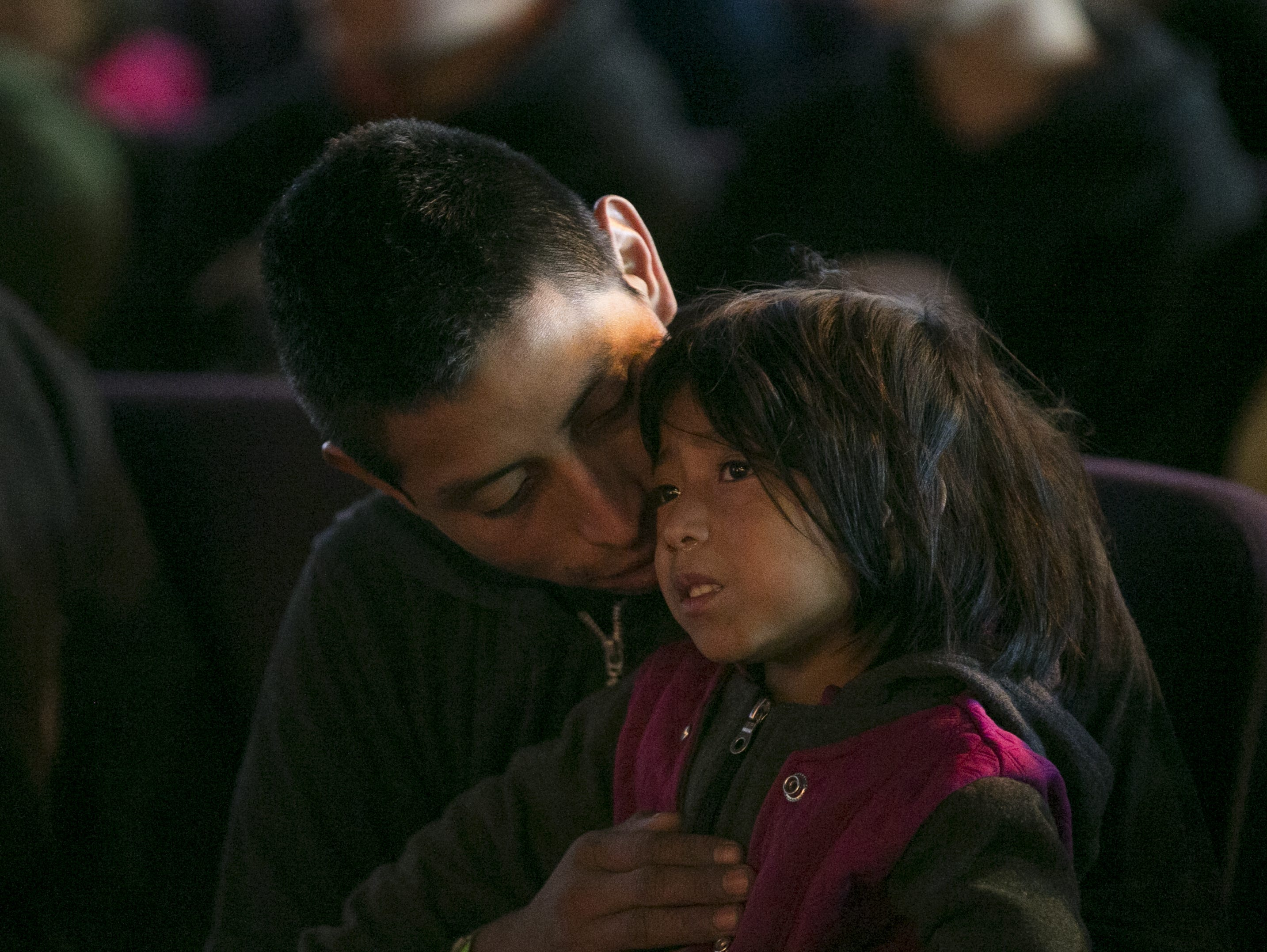 Guatemalan Asylum seeker Marcos Ramos Ortiz (left) holds his 4-year-old daughter Juana Ramos Gomez (right) at La Hermosa Church in Phoenix after being dropped off by U.S. Immigration Customs and Enforcement on Dec. 20, 2018.