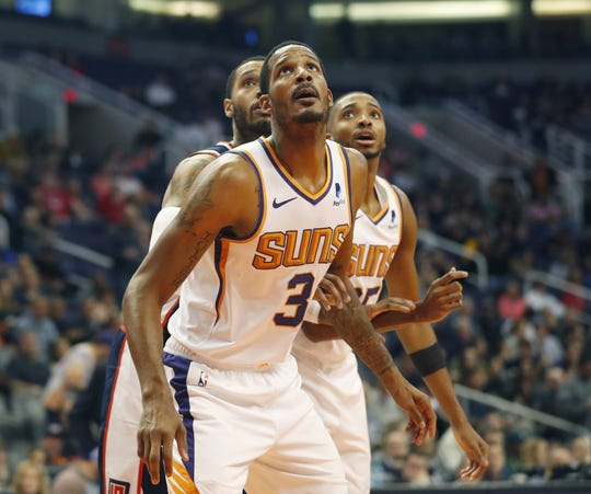 Suns forward Trevor Ariza looks for a rebound during a game Dec. 10 against the Clippers at Staples Center.