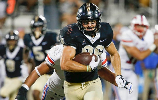 UCF tight end Michael Colubiale runs with the ball during a game against Southern Methodist on Oct. 6 at Spectrum Stadium.
