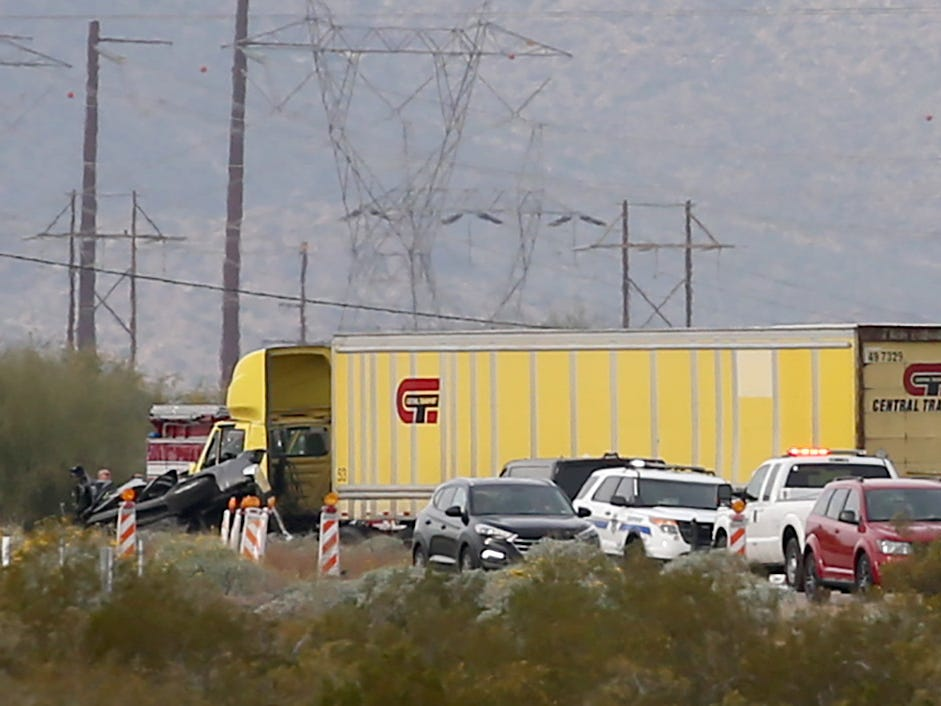 Traffic slows to a crawl as emergency personnel work on the scene of a multiple fatality collision on I-10 west of Pinal Airpark Road on Dec. 21, 2018, near Tucson.