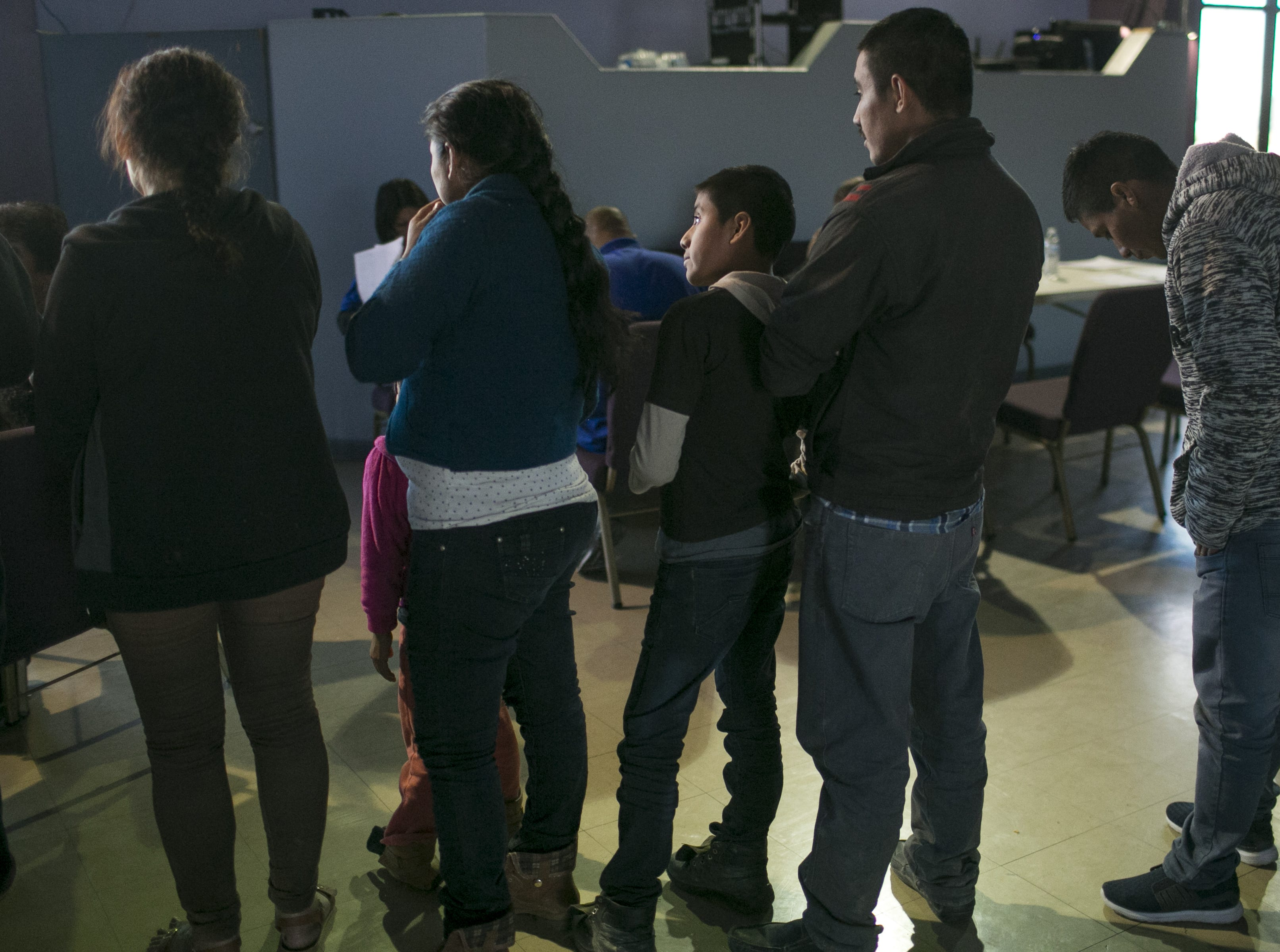 Asylum seekers and migrants from Central America wait at La Hermosa Church in Phoenix after being dropped off by U.S. Immigration Customs and Enforcement on Dec. 20, 2018. The Department of Homeland Security announced a policy forcing asylum seekers to await their status approval in Mexico.