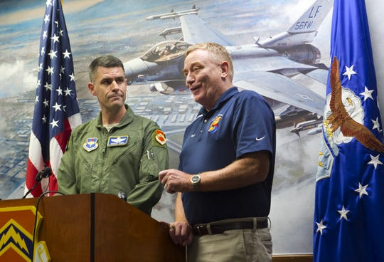 Colonel Robert Webb (left), vice commander of the 56th Fighter Wing, and Rusty Mitchell, director of the Community Initiatives Team with Luke Air Force Base, announce that Luke has been chosen as a training center for F-35 pilots on Aug. 1, 2012.