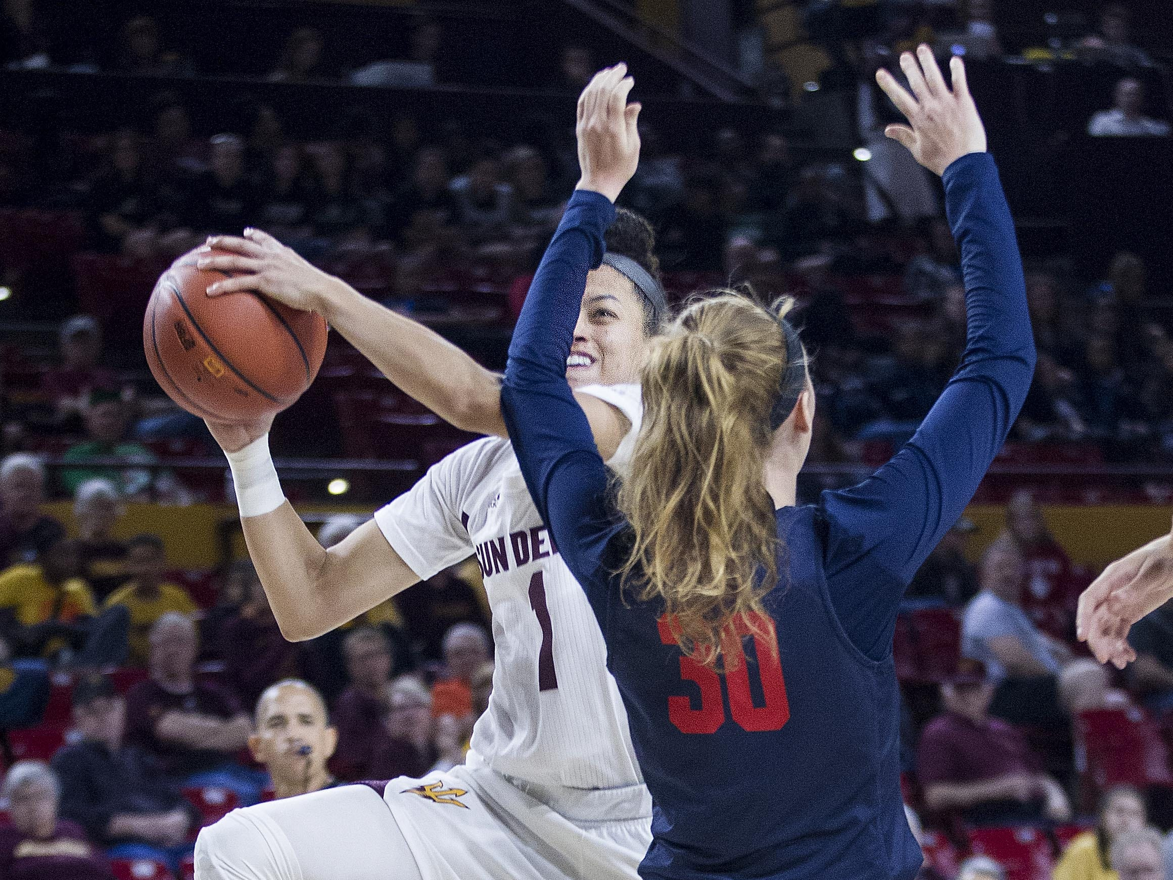 Arizona State's Reili Richardson (1) drives to the basket against Fresno State's Kristina Cavey (30) in the second half of their game in Tempe, Thursday, Dec. 20, 2018.