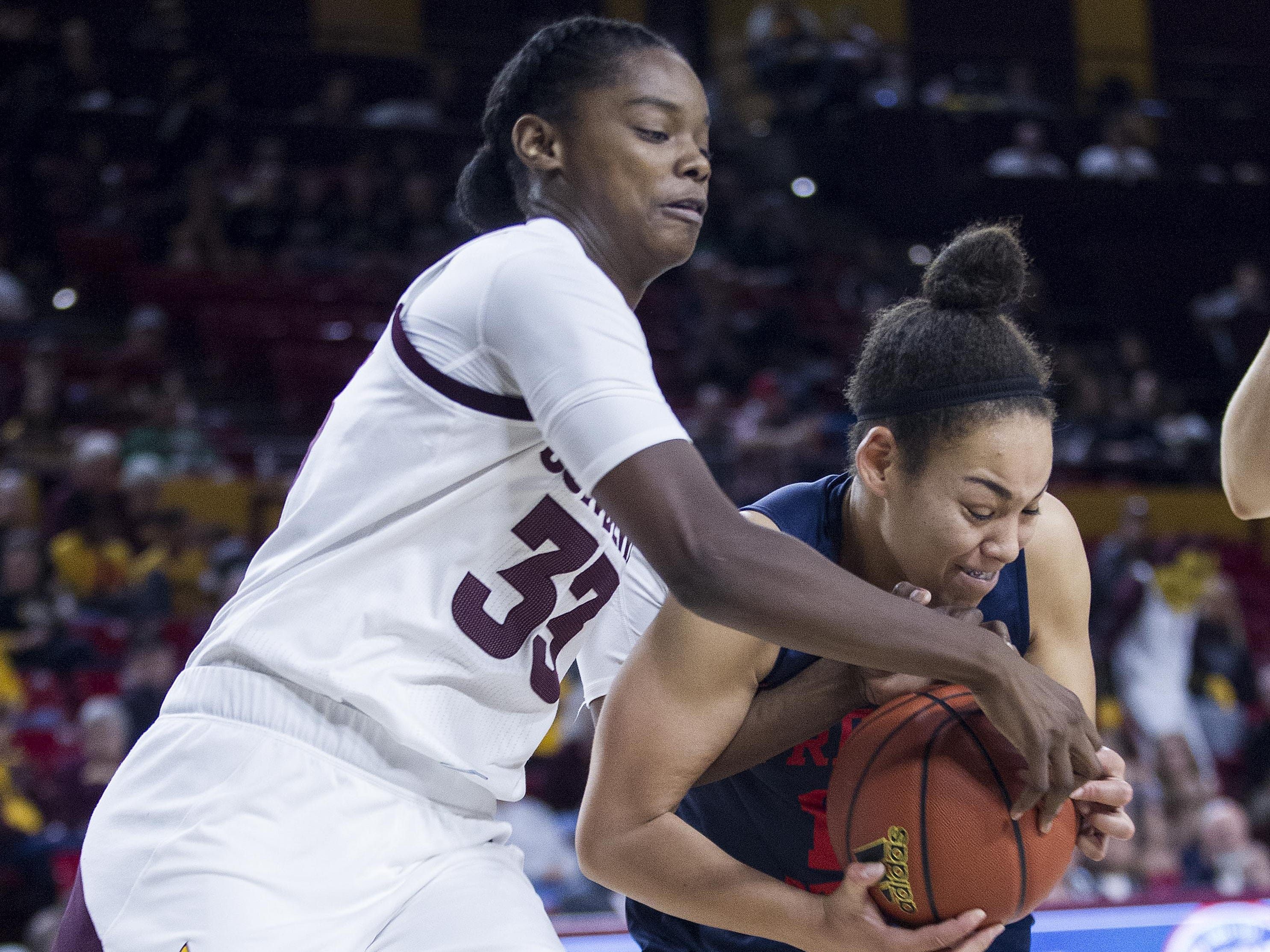 Arizona State's Charnea Johnson-Chapman (33) fights for a rebound with Fresno State's Candice White (10) in the second half of their game in Tempe, Thursday, Dec. 20, 2018.