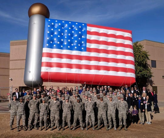 Each year, Fighter Country Partnership carries a flag balloon in the Fiesta Bowl Parade.