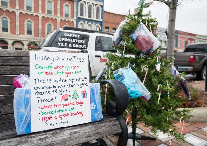 A holiday giving tree is set up on the corner of Water and Military streets in downtown Port Huron.