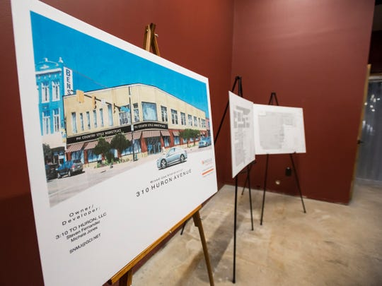 A rendering of what the Woolworth's building in downtown Port Huron will look like after being remodeled into PH Country Style Marketplace sits on an easel next to floorplans for the building.