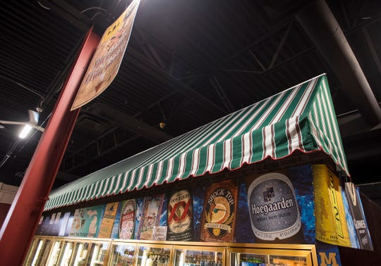 An awning has been hung in Country Style Marketplace that reflects what the awning on the front of PH Country Style Marketplace will look like.
