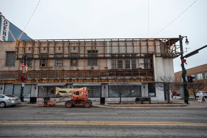 The metal facade on the Woolworth's building is being removed as part of a roof repair job. The owners of the building plan to keep the facade off and keep the original brick exposed.