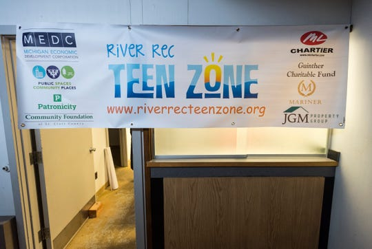 A banner with the River Rec Teen Zone's logo hangs on a wall inside the space in Marine City.