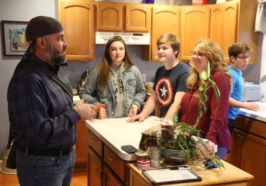Eric Munson with his family, from left, Abbi, Luke, wife Micki and Joshua at their home in Highland on December 20, 2018.  Eric discovered he had a brain tumor in January.
