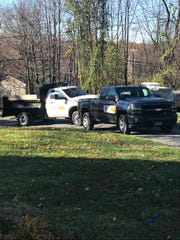Two Pornhub-branded trucks sit in the driveway of a Town of Poughkeepsie home.