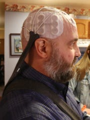 Eric Munson wears his Optune device at his home in Highland on December 20, 2018.  Eric discovered he had a brain tumor in January, and began using his Optune in the hopes that it will extend his life as long as possible.