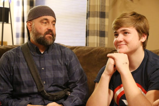 Eric Munson, with his son Luke at their home in Highland on December 20, 2018.  Eric discovered he had a brain tumor in January.