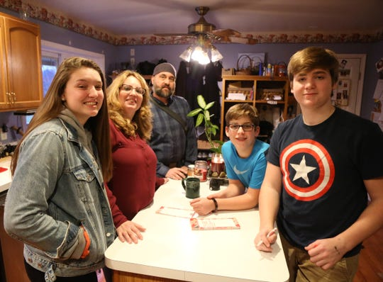 The Munson family, from left, Abbi, Micki Eric, Joshua Yeaw, and Luke before Eric heads out for an MRI at their home in Highland on December 20, 2018.  Eric discovered he had a brain tumor in January.