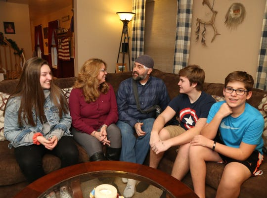 The Munson family, from left, Abbi, Micki, Eric, Luke and Joshua Yeaw at their home in Highland on December 20, 2018.  Eric discovered he had a brain tumor in January.