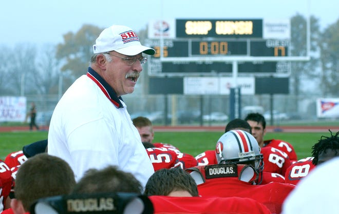 Rocky Rees talks to his Raiders players.