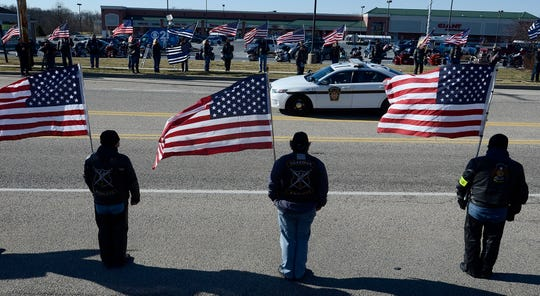 The Guardian Knights along with other motorcycle clubs, form a flag line in honor of US Marshal Christopher Hill, Thursday, January 25, 2018. John A. Pavoncello photo