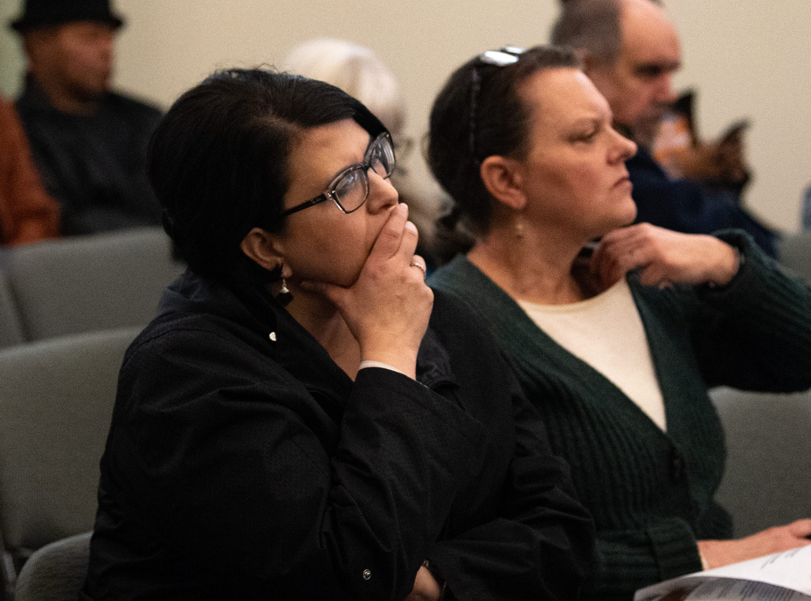 Tammy Bowers (left) listens intently as the speakers share their call to action during the No Hate in Our State town hall meeting at the West Manchester Township Building, December 20, 2018.