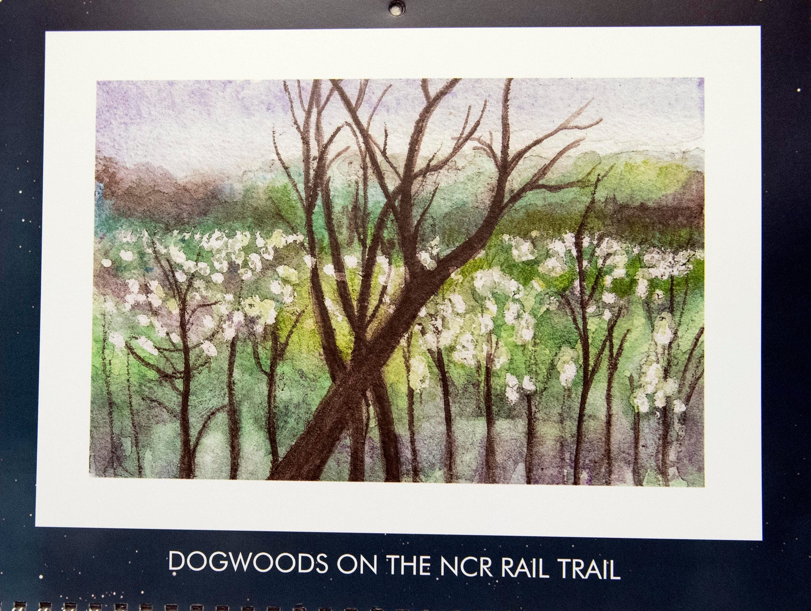 Mary Magenta always uses one of her favorite paintings for her birthday month — April — like this scene as dogwood tries start to bloom. Magenta's 2019 calendar, 'Around Here,' features many places from York County.