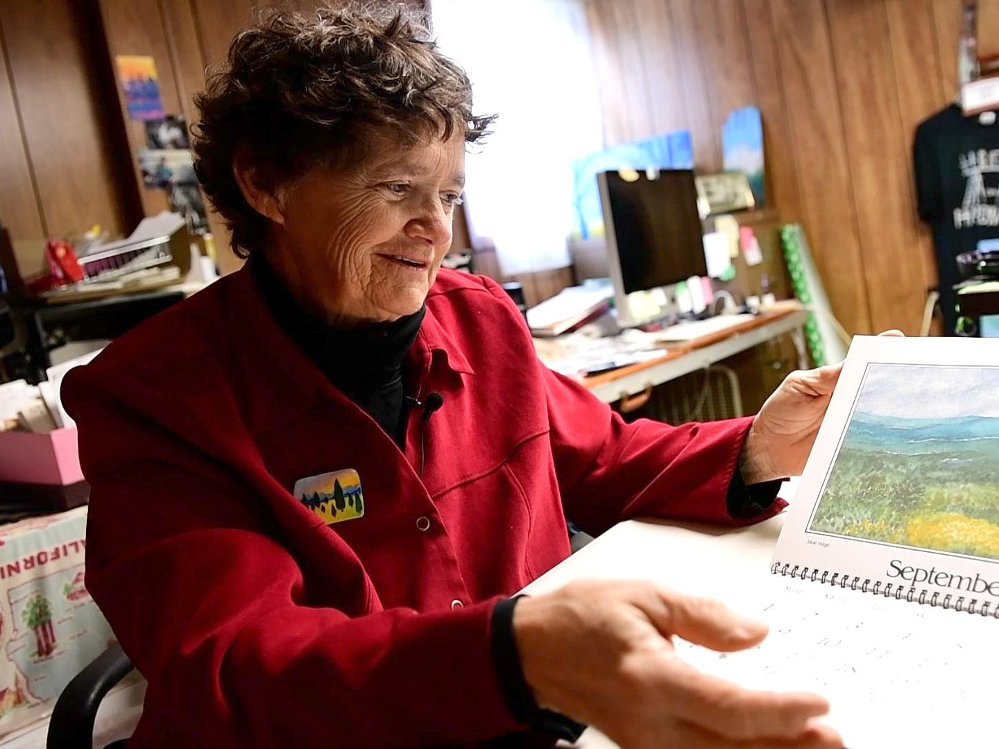 New Freedom artist Mary Magenta flips back through one of her many old calendars, Friday, Dec. 21, 2018. She's been making calendars since she was in high school and says that they're a 'slideshow of my life.'