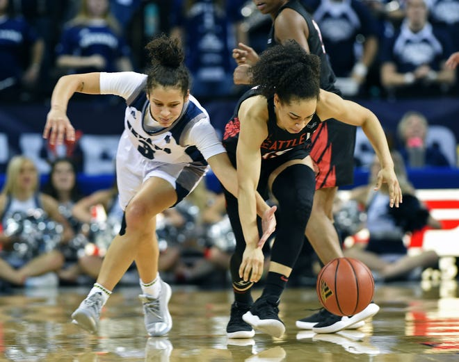Nevada's Essence Booker, left, goes for the steal against Seattle's Kamira Sanders during Thursday night's game at Lawlor Events Center.