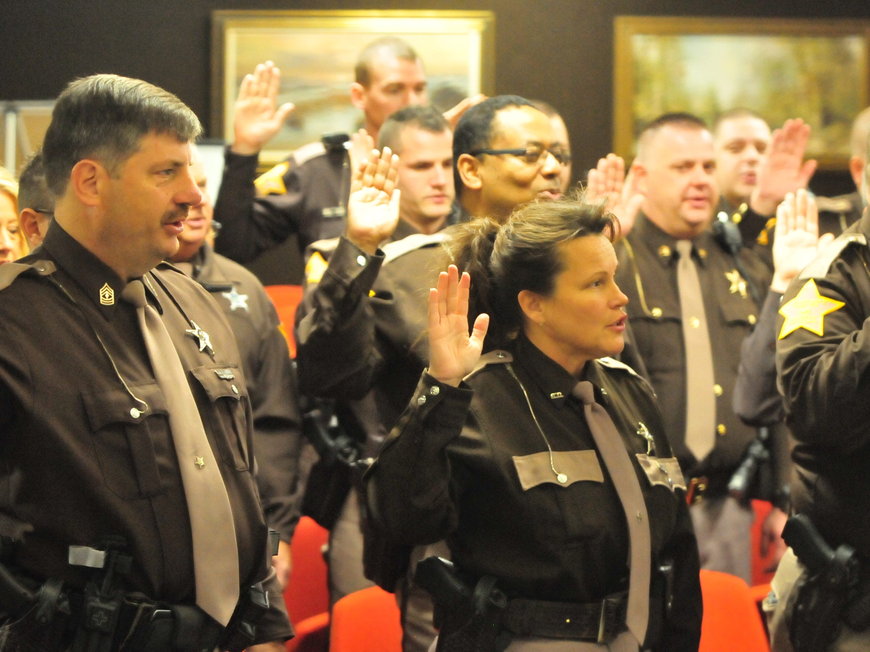 Wayne County Sheriff's Office personnel are sworn in Friday by Wayne County Clerk Debra Berry.