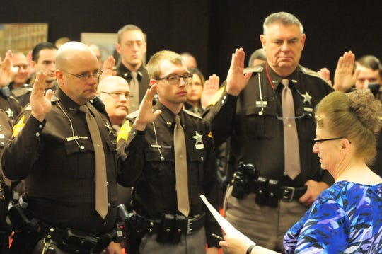 Wayne County Clerk Debra Berry swears in Wayne County Sheriff's Office personnel Friday.