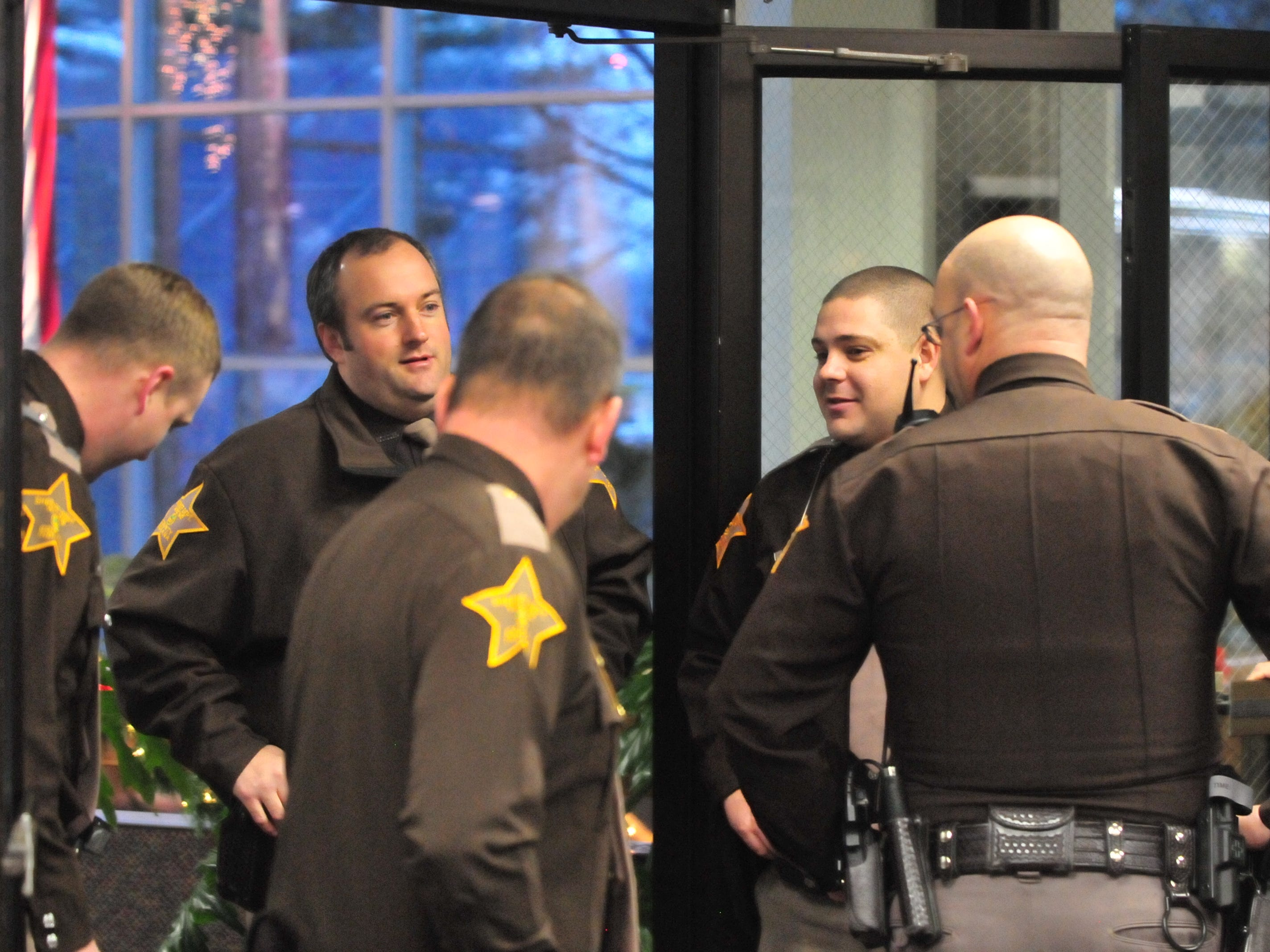Wayne County Sheriff's Office personnel visit Friday prior to a group swearing in ceremony.