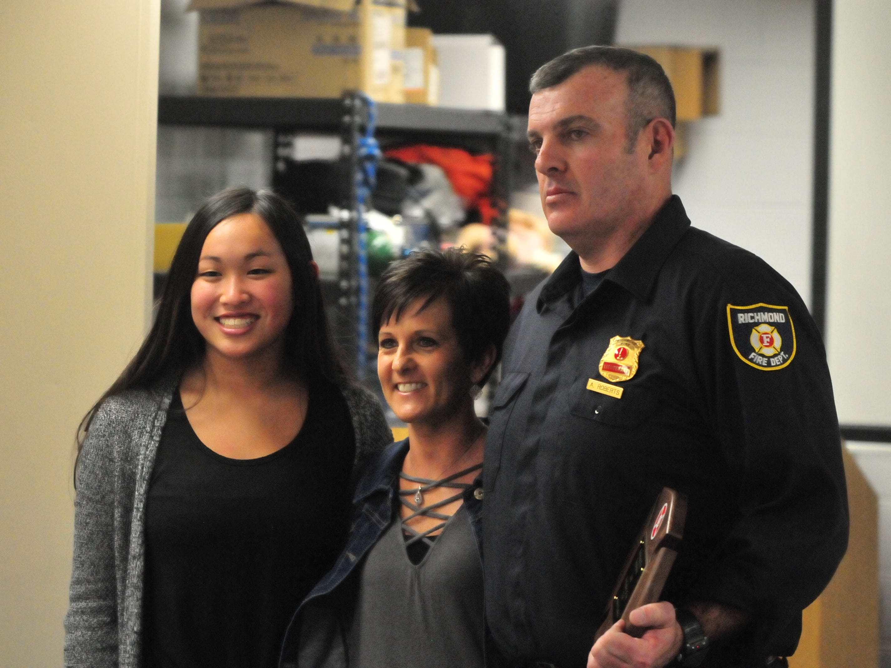 Lt. Andrew Roberts poses with his daughter Jayda (left) and wife Melanie after he was chosen Richmond Fire Department's Firefighter of the Year for 2018.