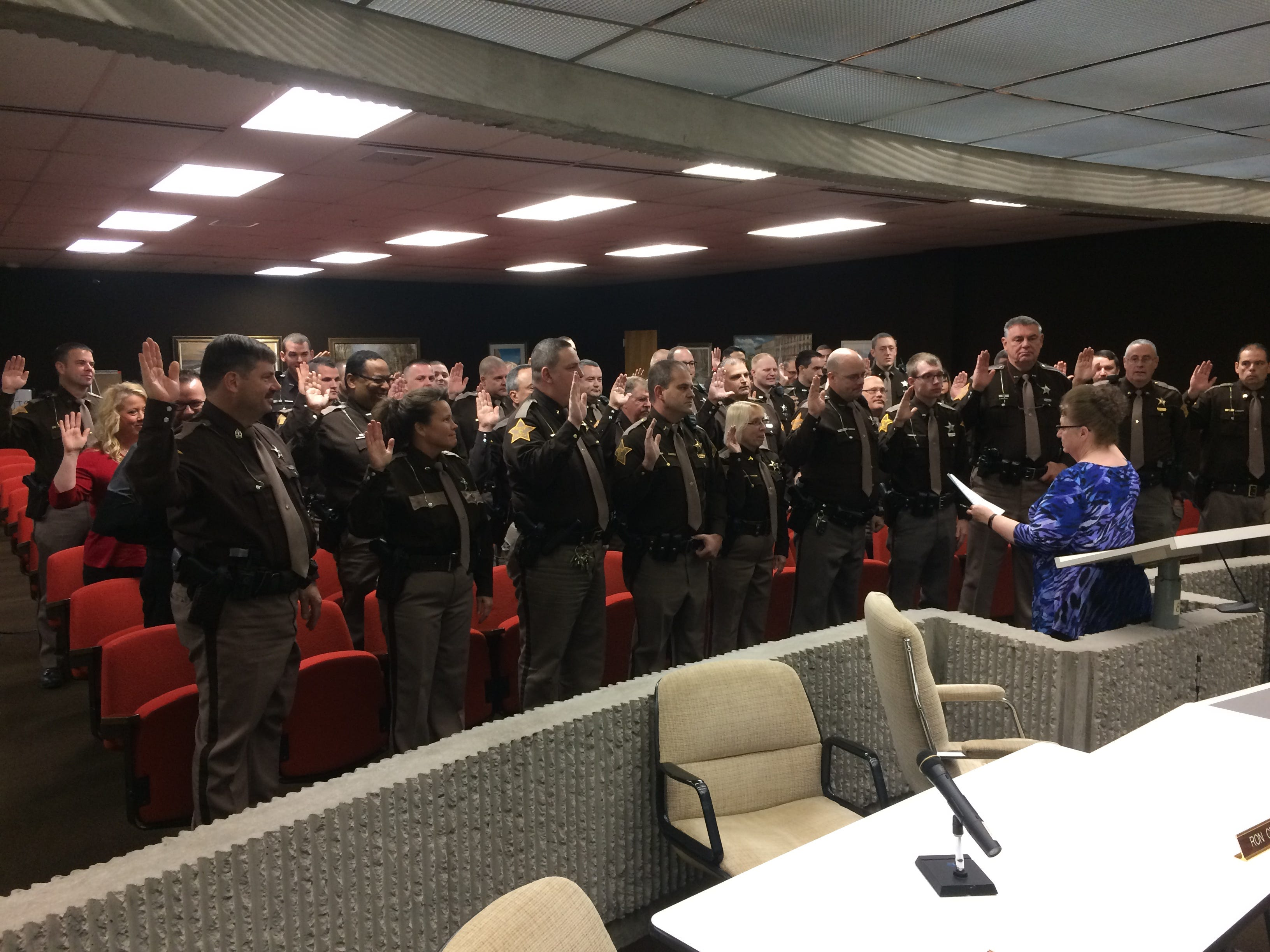Wayne County Clerk Debra Berry swears in Wayne County Sheriff's Office personnel Friday.