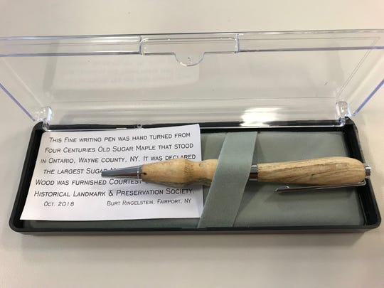 A pen carved of wood from the largest sugar maple in New York by pen maker Burt Ringelstein of Fairport.