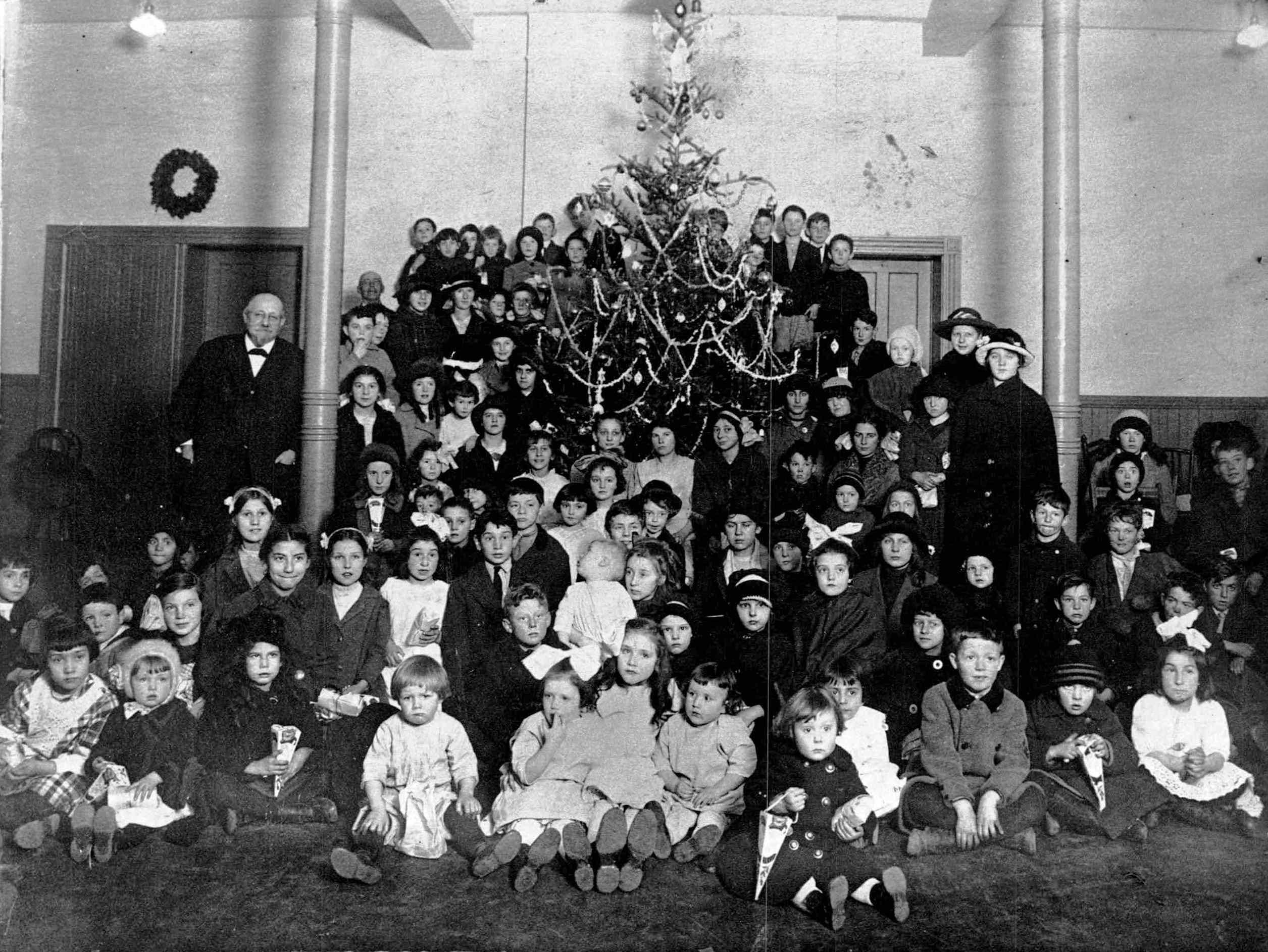 A group of Rochester children gathered around the Exposition Park Christmas Tree, circa 1914. The older man in the overcoat to the left is Rochester's colorful mayor Hiram Edgerton.