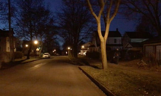 An area resident, with just his light colored hat and gloves visible, walks down Woodbine Avenue towards Genesee  Park Blvd. Dec. 20, 2018.  Dark clothes late at night or before day break has been one of the factors in pedestrian vs. car accidents.