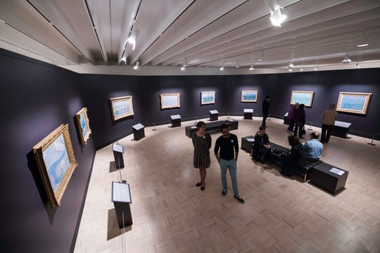 """Visitors to """"Monet's Waterloo Bridge: Vision and Process"""" exhibit at the Memorial Art Gallery are seen October 12, 2018. Claude Monet's """"Waterloo Bridge"""" series includes the example from MAG's collection along with seven others borrowed from North American sister institutions."""