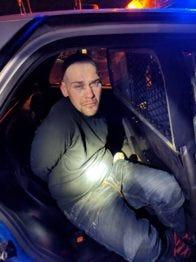 Matthew Ryan Watson in police custody.